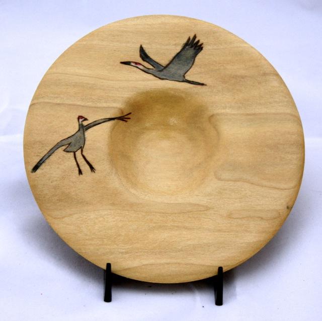 platter with woodburned sandhill cranes