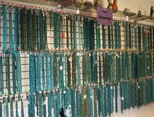 wall display of turquoise strands