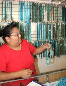 Linda showing turquoise necklace