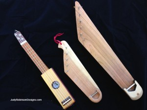 Compare sizes of travel ukulele to sopranino kantele and 5-string larger kantele (left).