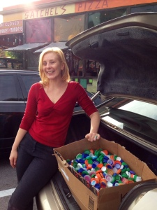 Leah with several years worth of collected bottle tops