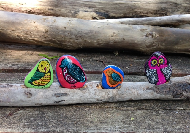 birds painted on stones