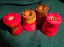 Red, yellow, green dyed knitting spools