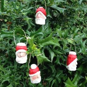 wooden Santa ornaments by Judy Robinson