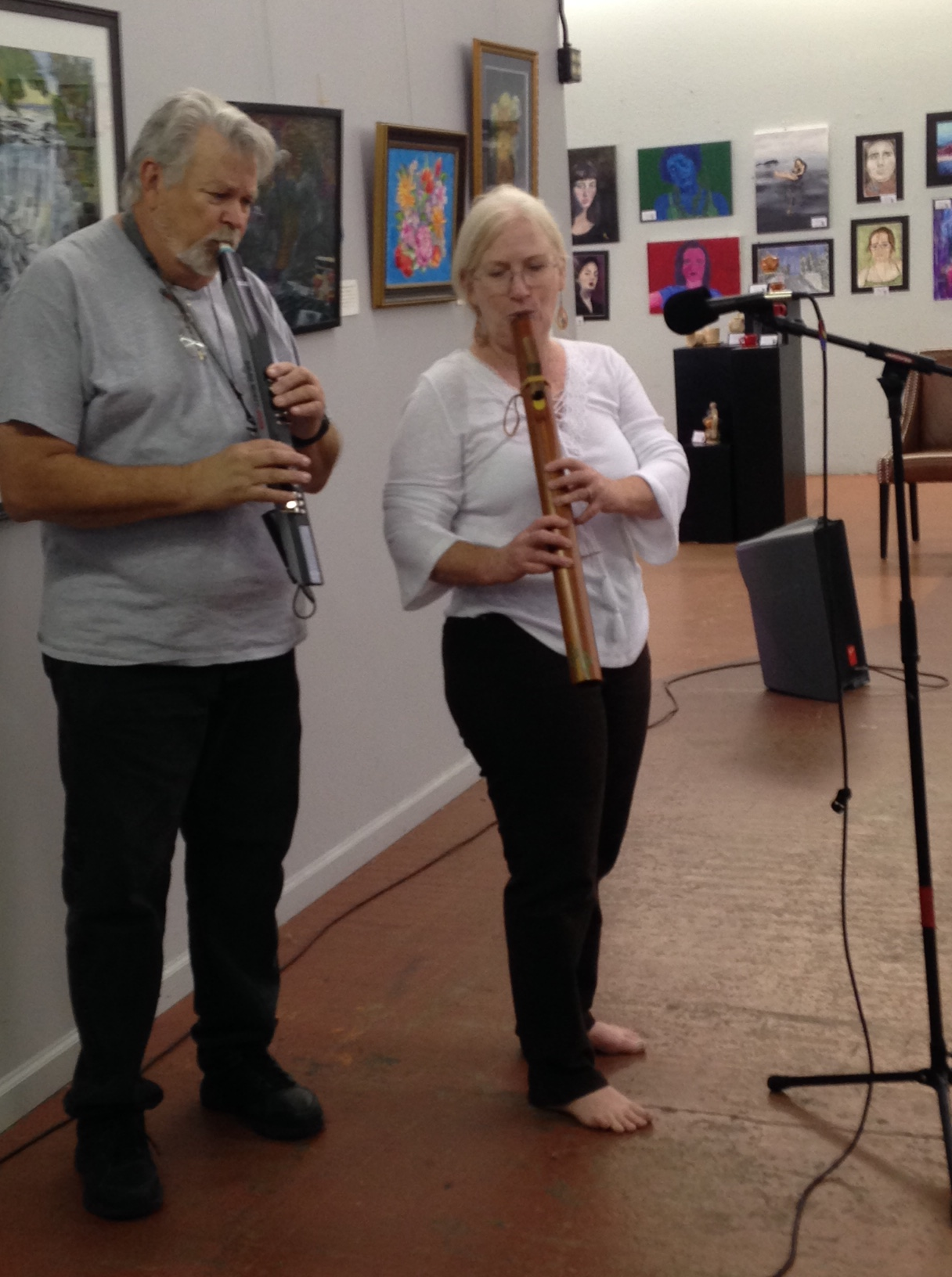 Tom, playing an electronic flute with Deb on a low C wood Native American style flute.